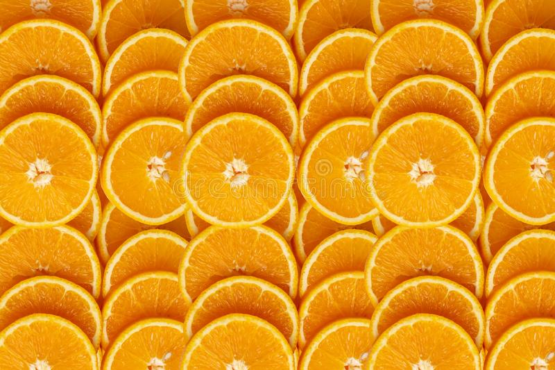 Backgrounds and textured of orange fruits line up in full frame. The result is sour or sweet. Contains calcium, potassium, vitamin A and C, summer, organic stock photo