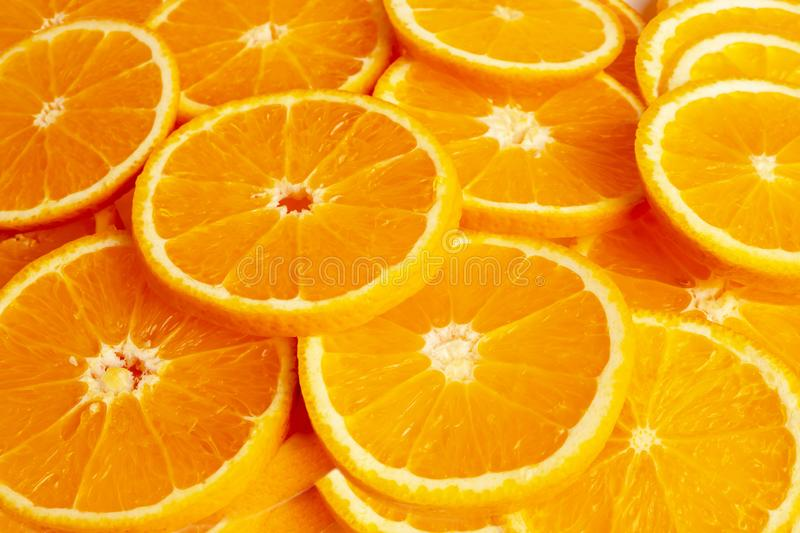 Backgrounds and textured of orange fruits into piece. Close up backgrounds and textured of orange fruits into piece. The result is sour or sweet. Contains royalty free stock images