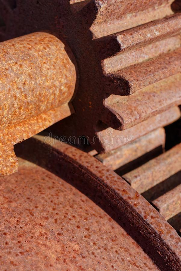 Old rusted cogwheels. Backgrounds and textures: pair of rusty steel cogwheels, closeup shot, industrial abstract royalty free stock photo