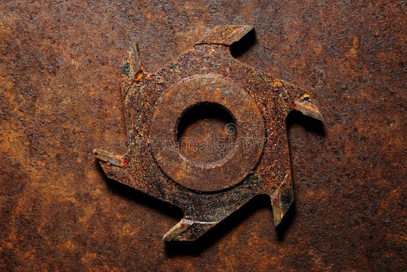 Old milling cutter on rusty metal background royalty free stock photography