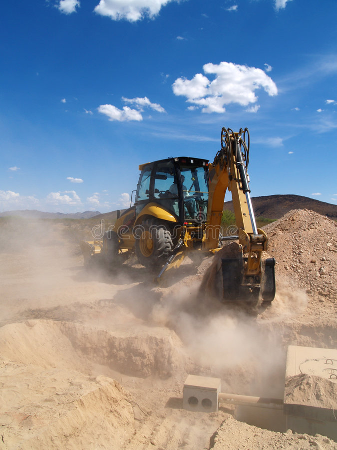 Backhoe Digging at Construction Site stock photography