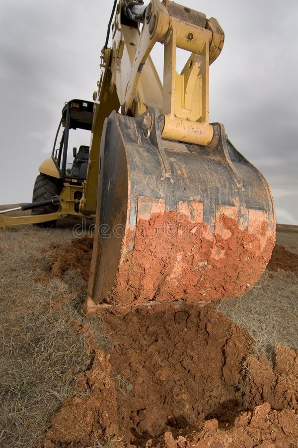 Free Backhoe Digging In Red Dirt. Stock Images - 4665764