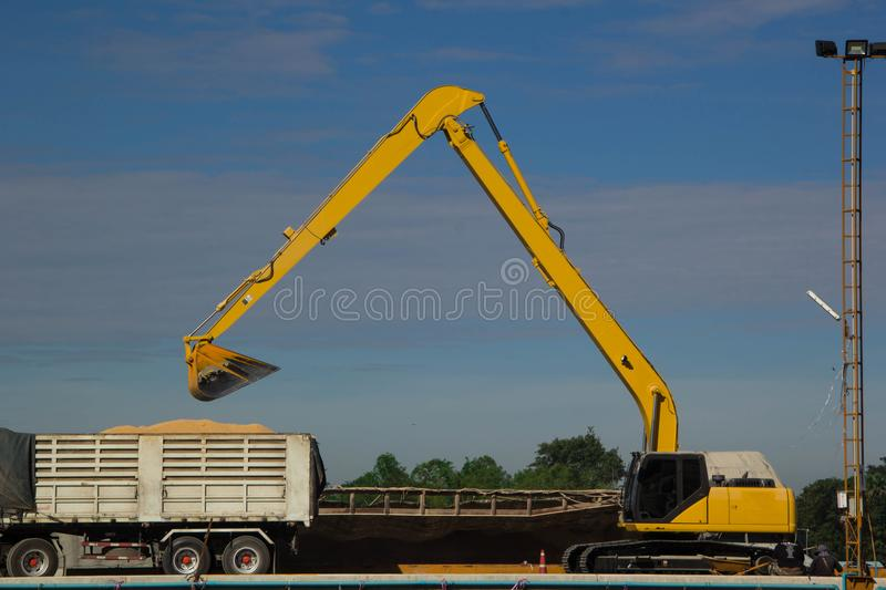 Backhoe loading a dump truck. In a quarry royalty free stock image