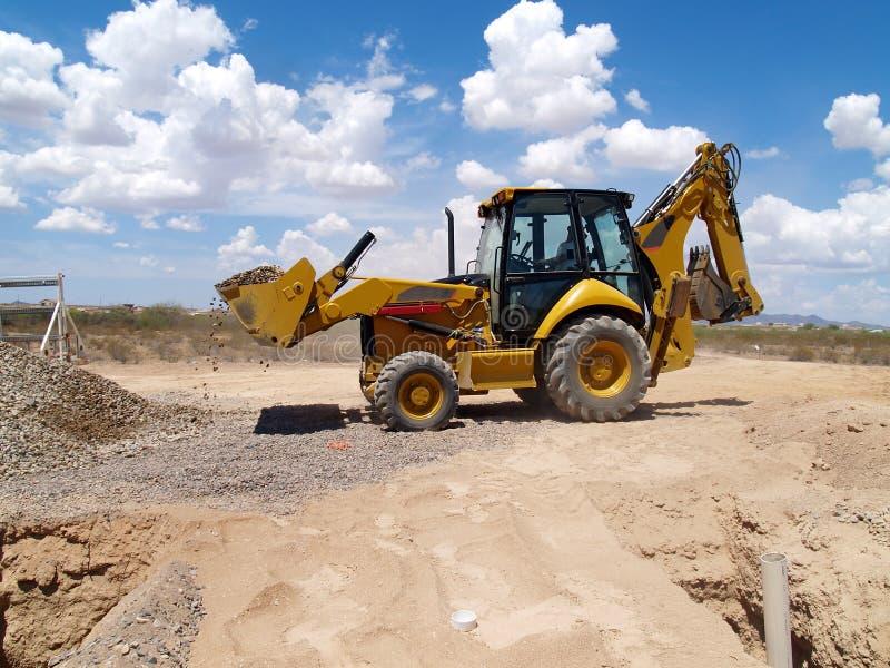 Download Backhoe Shoveling Gravel stock photo. Image of shovel - 6413410