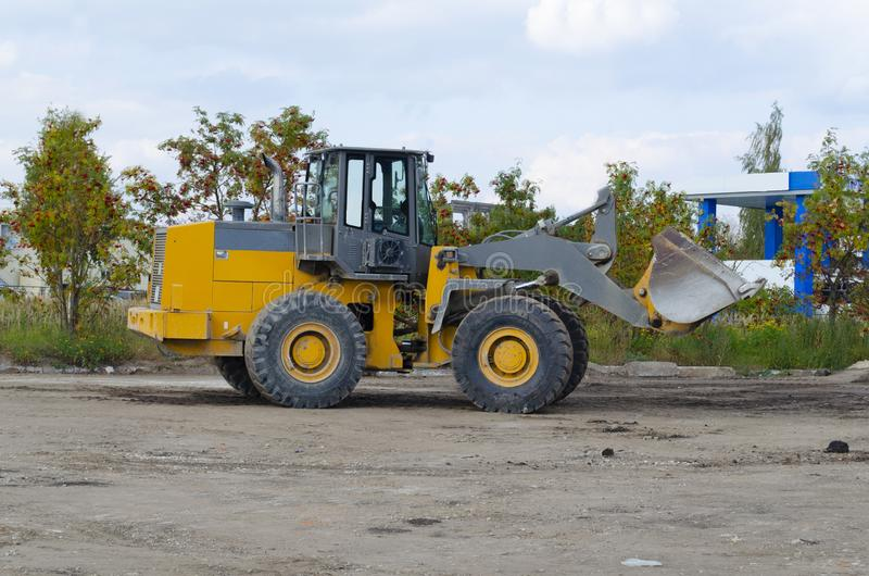 Backhoe to excavate the soil on the ground.construction site excavator.wheel loader royalty free stock image