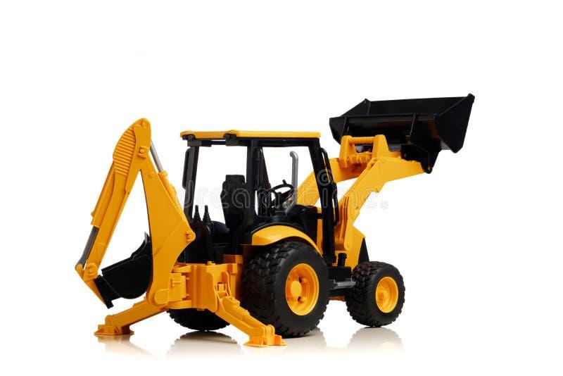 Backhoe tractorstuk speelgoed op wit royalty-vrije stock afbeeldingen