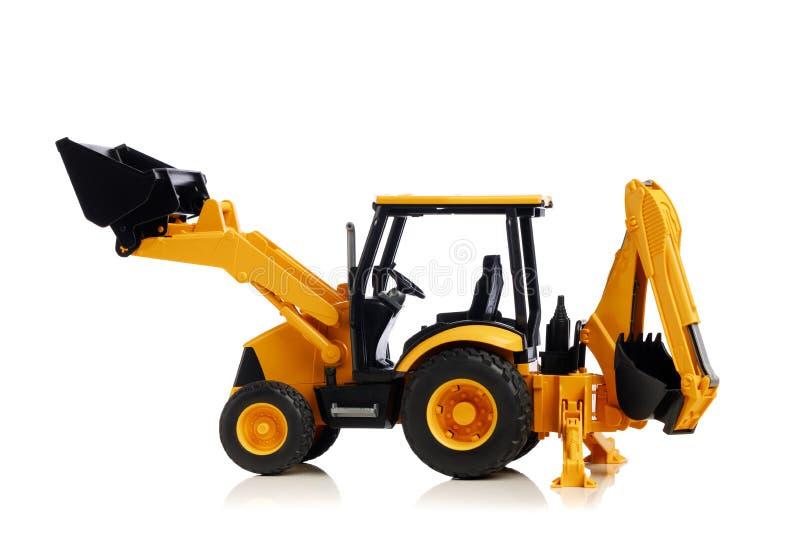 Backhoe tractorstuk speelgoed op wit stock fotografie