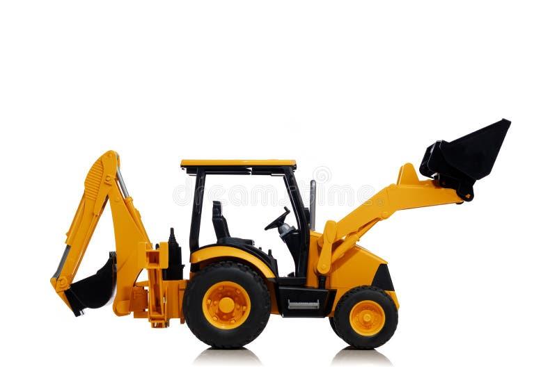 Backhoe tractorstuk speelgoed op wit royalty-vrije stock foto