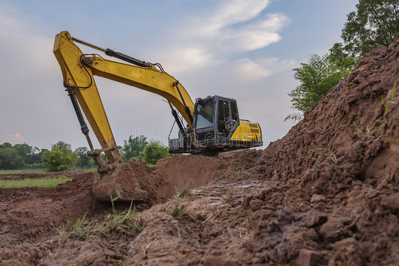 Backhoe. View from backhoe was digging a pit in the ground for rainwater,Crawler excavator truck ,Construction digger machine in flat. Backhoe loader, Heavy royalty free stock photos