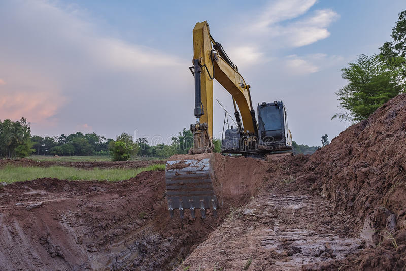 Backhoe. View from backhoe was digging a pit in the ground for rainwater,Crawler excavator truck ,Construction digger machine in flat. Backhoe loader, Heavy stock photo