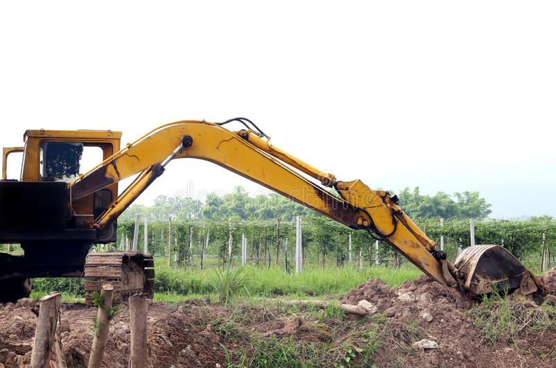 Backhoe was digging a pit in the ground. Crawler excavator truck stock photos