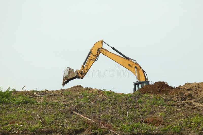 The backhoe was digging soil on top mountain royalty free stock images