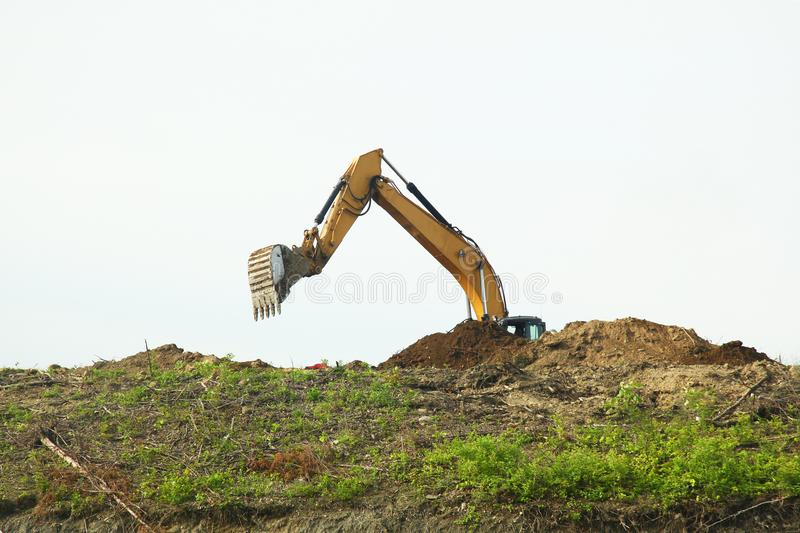 The backhoe was digging soil on top mountain royalty free stock photo