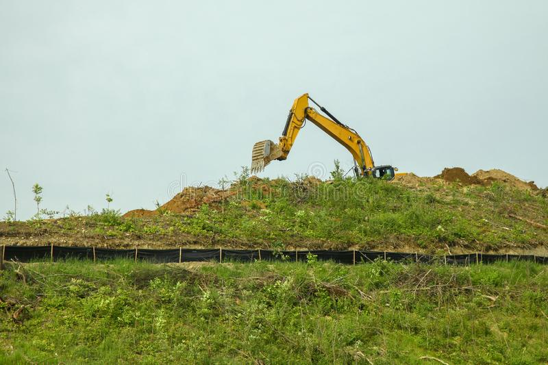 The backhoe was digging soil on top mountain in USA stock photos