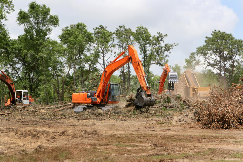 Backhoes Clearing Land stock photo