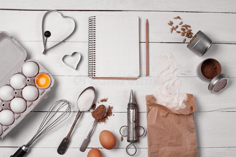 Backing background with ingredients for baking and kitchen tools. Backing background with ingredients for baking apple pie and kitchen tools stock photos