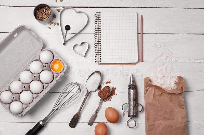 Backing background with ingredients for baking and kitchen tools. Backing background with ingredients for baking apple pie and kitchen tools royalty free stock image
