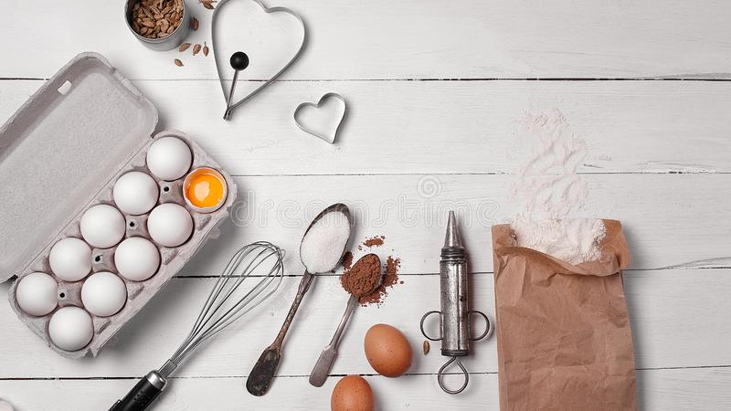 Backing background with ingredients for baking and kitchen tools. Backing background with ingredients for baking apple pie and kitchen tools royalty free stock photography
