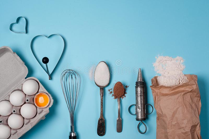 Backing background with ingredients for baking and kitchen tools. Backing background with ingredients for baking apple pie and kitchen tools stock photo