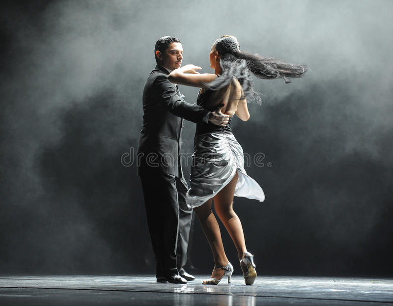 Backlight tough guy-the identity of the mystery-Tango Dance Drama. Fernanda Ghi and Guillermo Merlo is Argentina's most famous tango dancer, is also a famous royalty free stock photo
