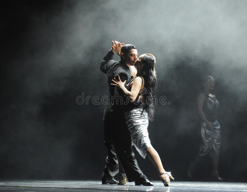 Backlight tough guy-the identity of the mystery-Tango Dance Drama. Fernanda Ghi and Guillermo Merlo is Argentina's most famous tango dancer, is also a famous stock photo