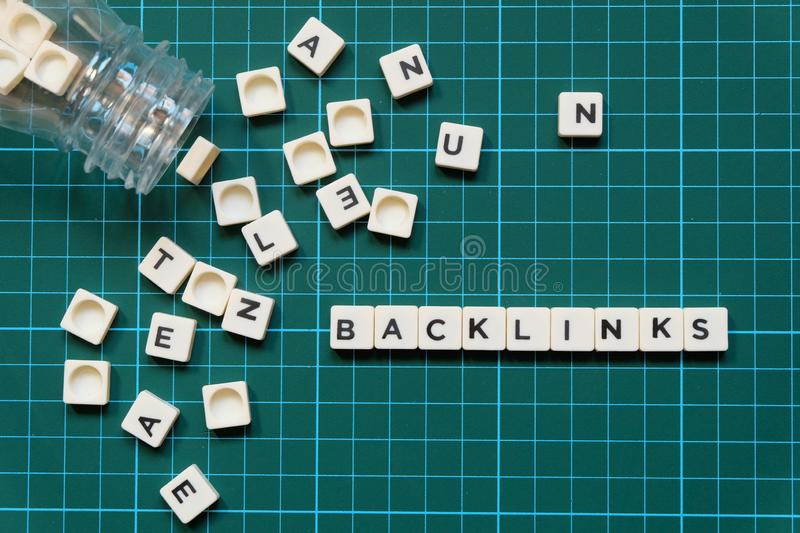 Backlinks word made of square letter word on green square mat background. stock photo