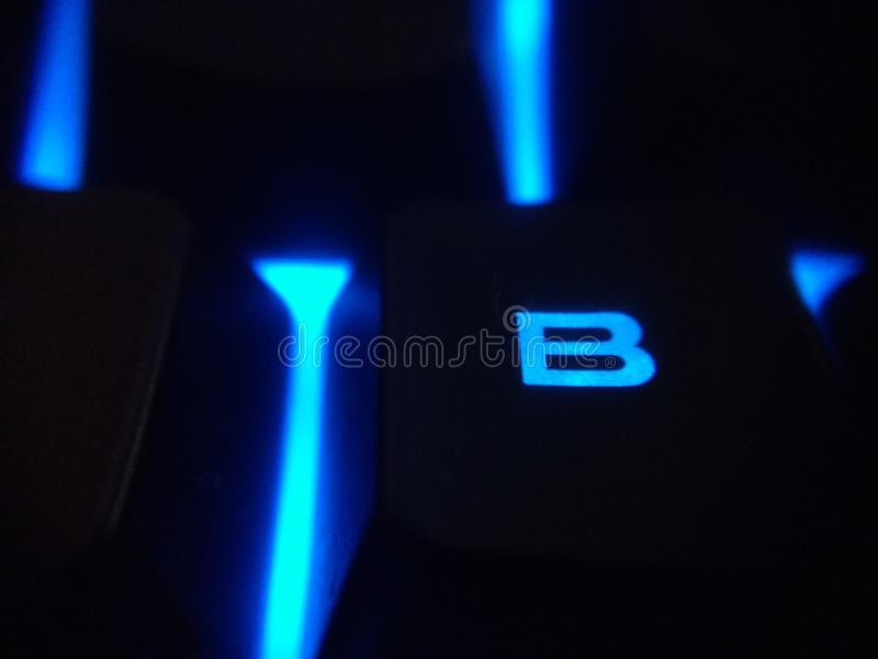 Backlit błękitny dowodzony klawiaturowy b fotografia stock