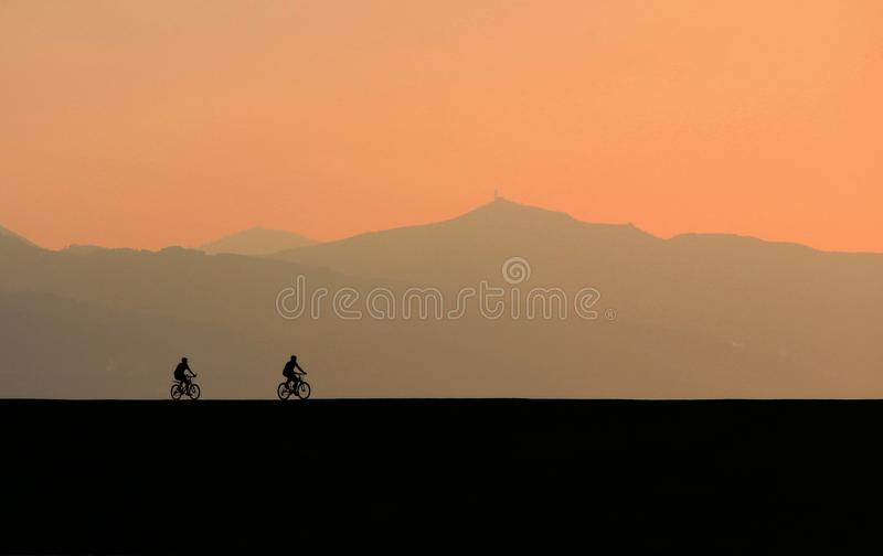 Backlit, Bicycles, Clouds royalty free stock images