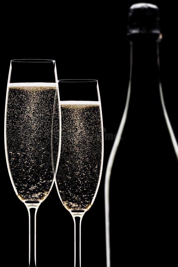 Backlit champagnefluiten stock foto