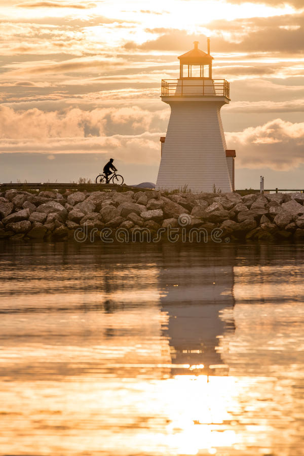 Backlit Lighthouse in Gaspe Peninsula. New Richmond, Quebec, Canada stock photo