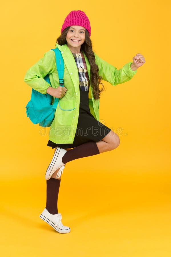 Backpack as fashion accessory. Girl little fashionable cutie carry backpack. Modern backpack for daily life. Teen stock photo
