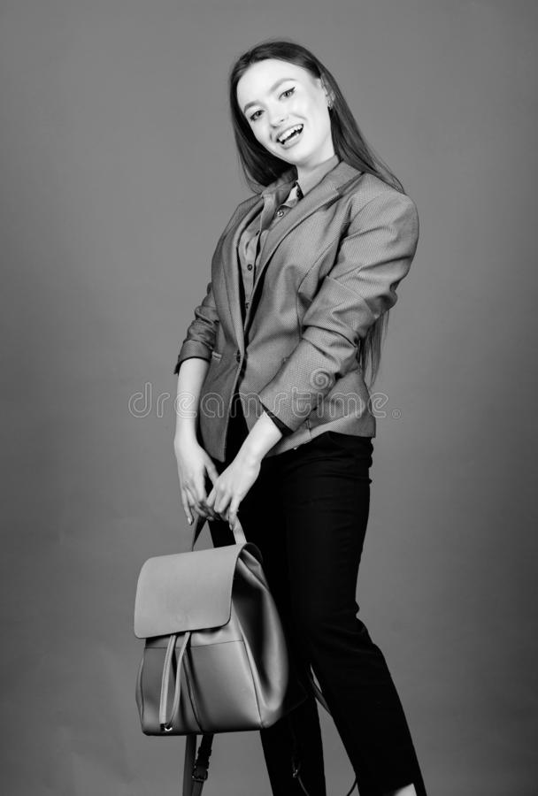 Backpack fashion trend. Stylish woman in jacket with leather backpack. Formal style accessories. Backpack for daily stock photo