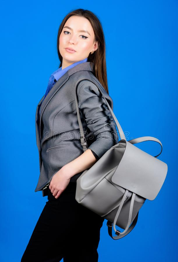 Backpack fashion trend. Woman with leather knapsack. Stylish woman in jacket with leather backpack. Formal style. Accessories. Backpack for daily modern urban stock photography