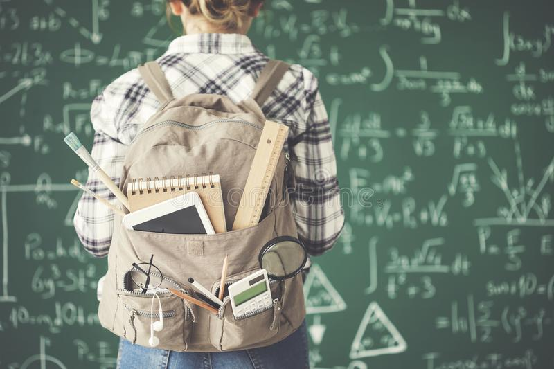 Backpack female student chalkboard background stock photos