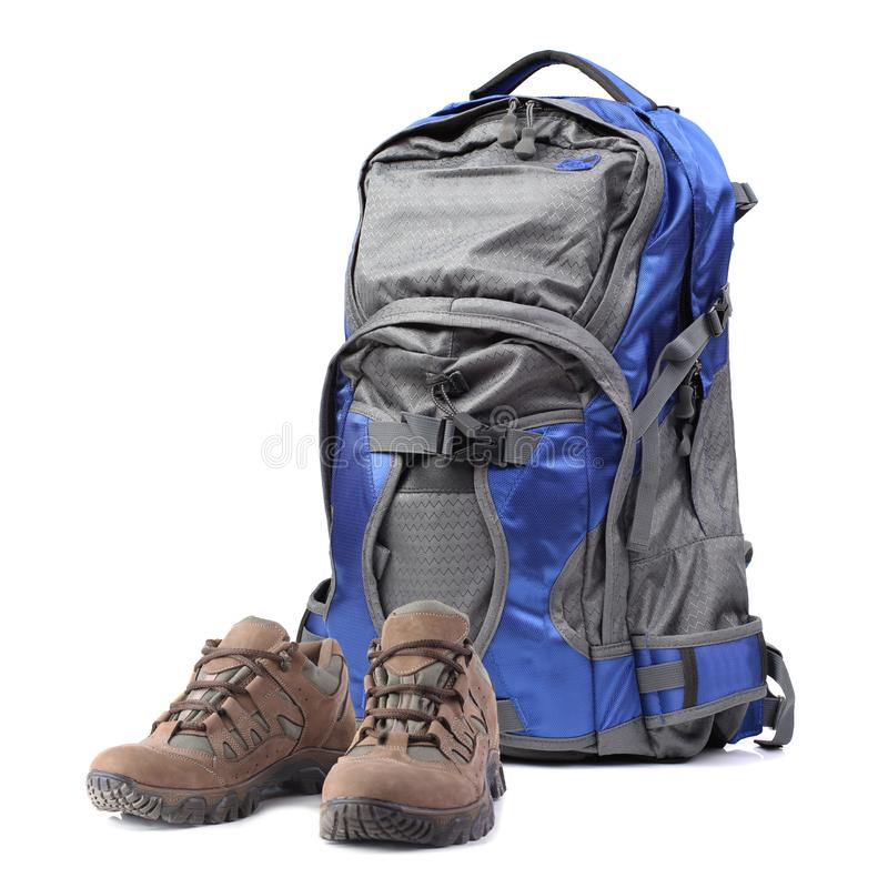 Backpack and hiking boots isolated on white. Background royalty free stock photo