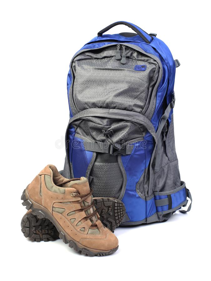 Backpack and hiking boots isolated on white. Background stock photography
