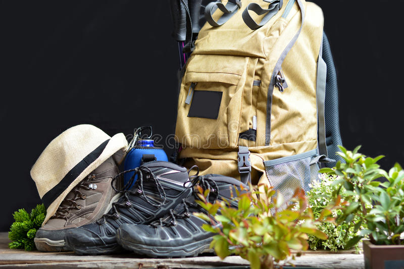 Backpack hiking with boots of mountain. And water bottle stock photography