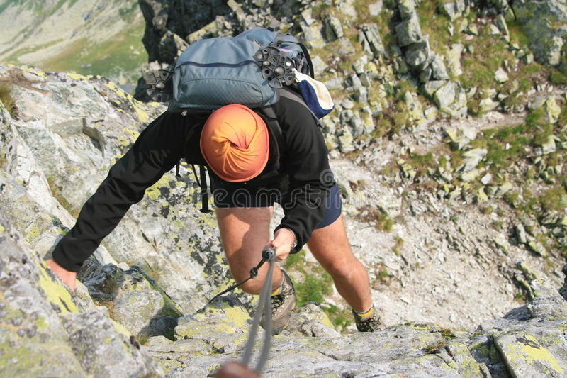 Backpack man climbing royalty free stock photography