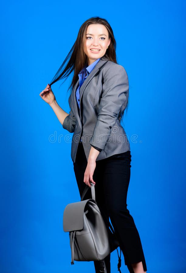 Backpack for daily modern urban life. Woman with leather knapsack. Girl student in formal clothes. Backpack fashion. Trend. Stylish woman in jacket with leather stock images