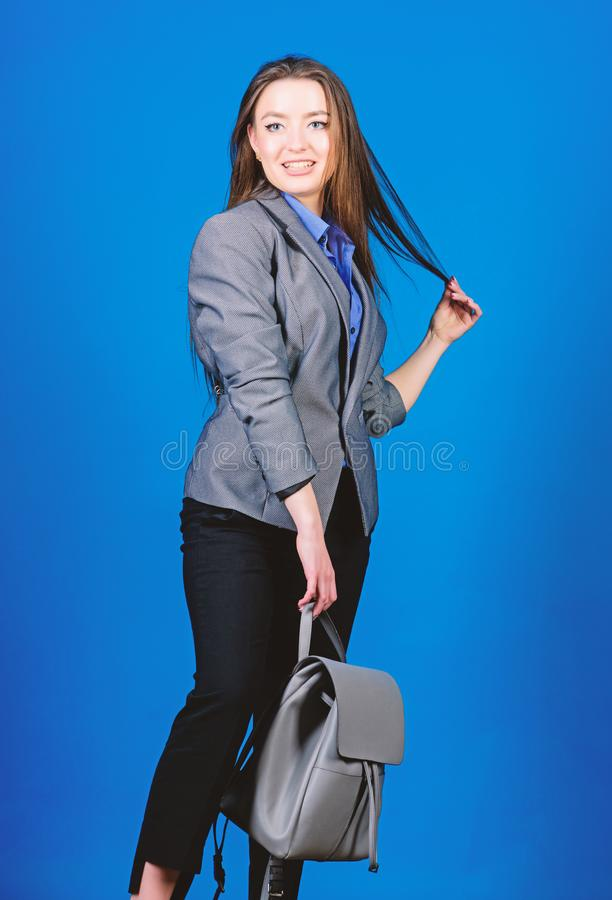Backpack for daily modern urban life. Woman with leather knapsack. Girl student in formal clothes. Backpack fashion. Trend. Stylish woman in jacket with leather royalty free stock image
