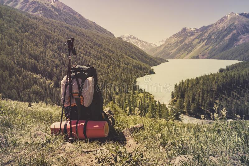 Backpack mountaineering Travel Lifestyle concept lake and mountains on background Summer expedition vacations outdoor. Backpack mountaineering, Travel Lifestyle stock photo
