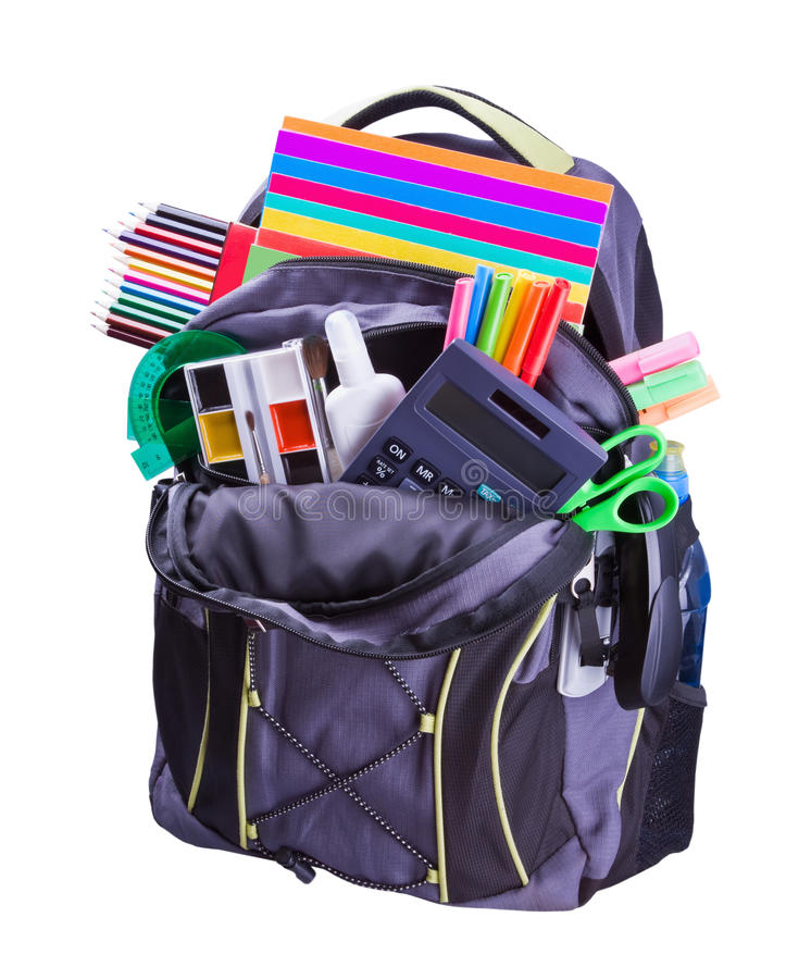 Backpack with school supplies. Including, notebooks, pens, pencils, rulers and glue stock images