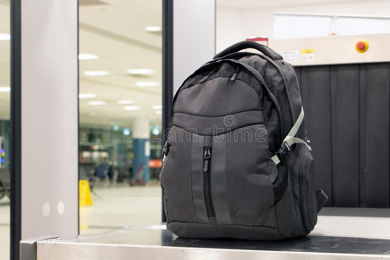 Backpack standing in front of luggage scanner royalty free stock photos