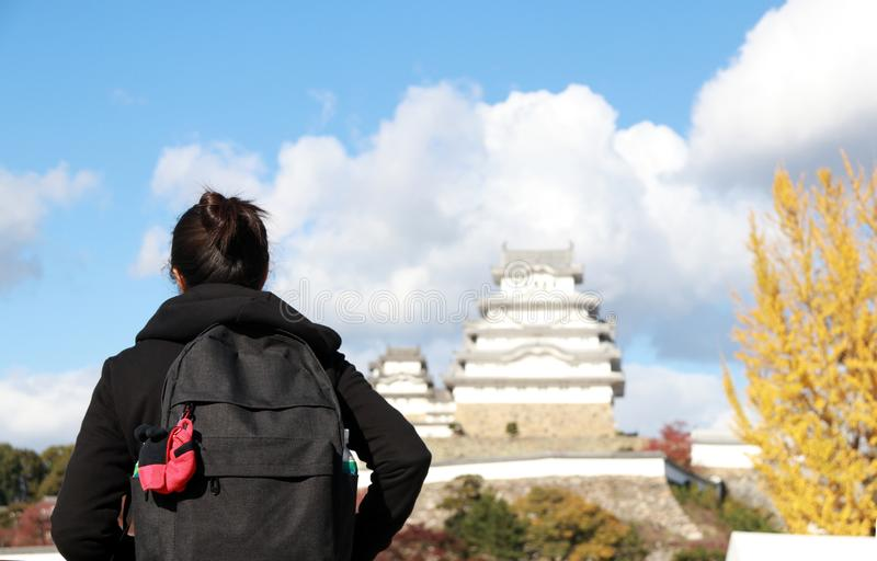Backpack of tourist on autumn at Himeji Castle with yellow tree stock photo
