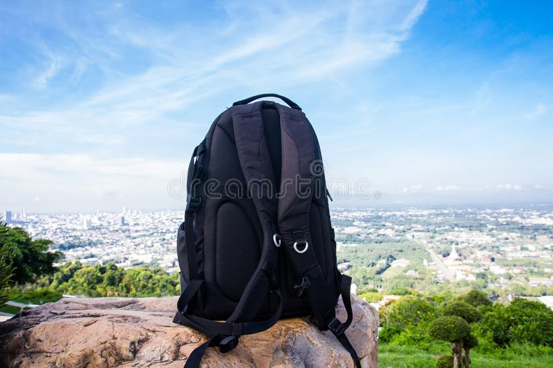 Backpack for traveler on the stone royalty free stock photos