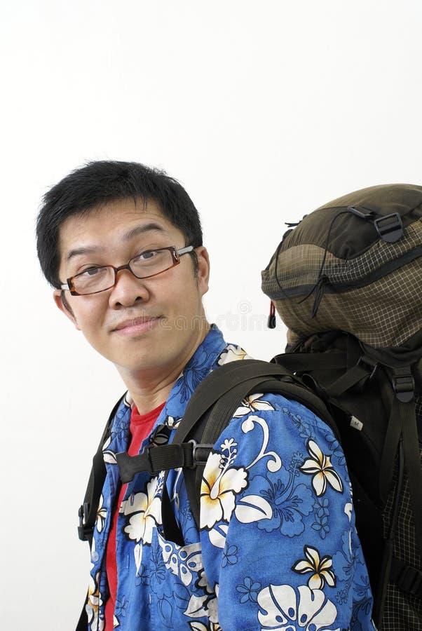 Backpacker asiático cómodo imágenes de archivo libres de regalías