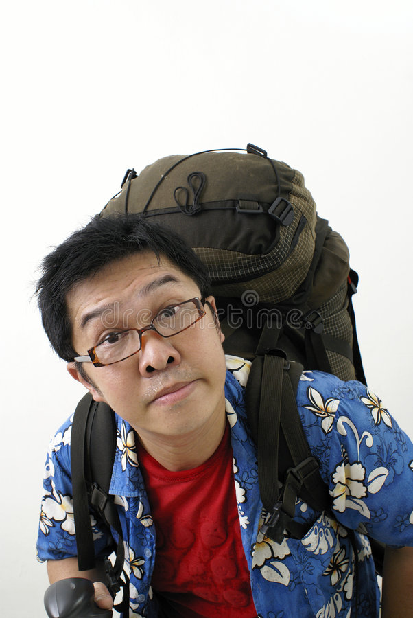 Backpacker asiático cansado fotografía de archivo