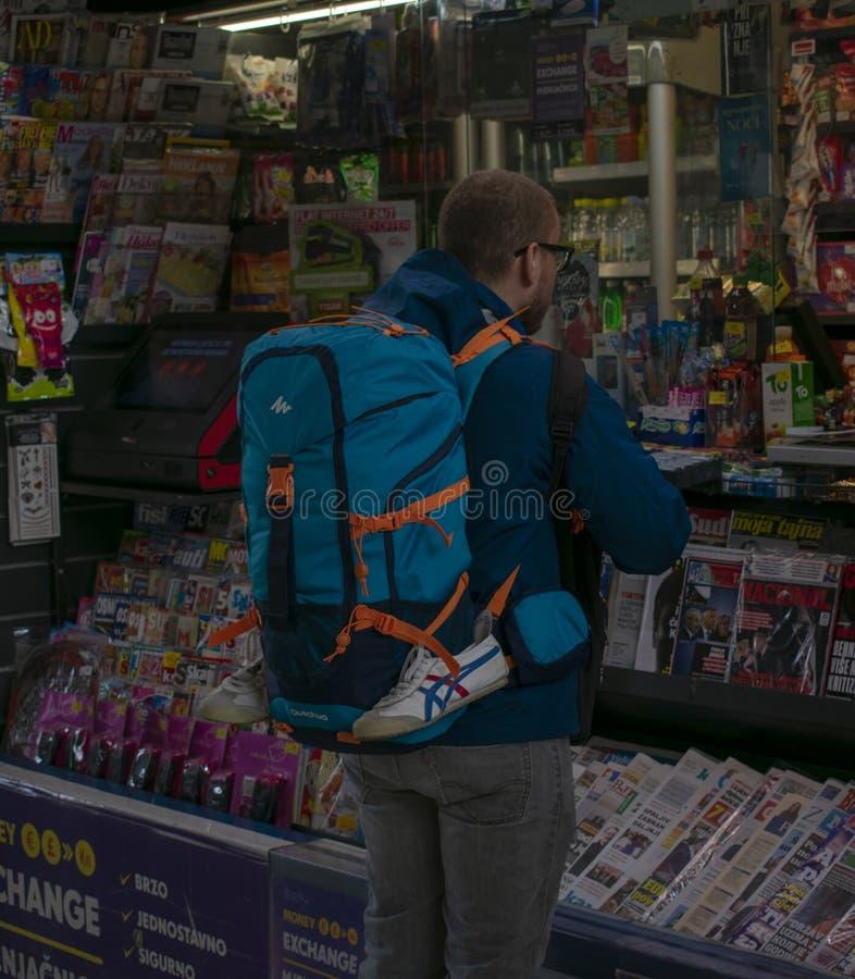 Backpacker buying a soda stock photo