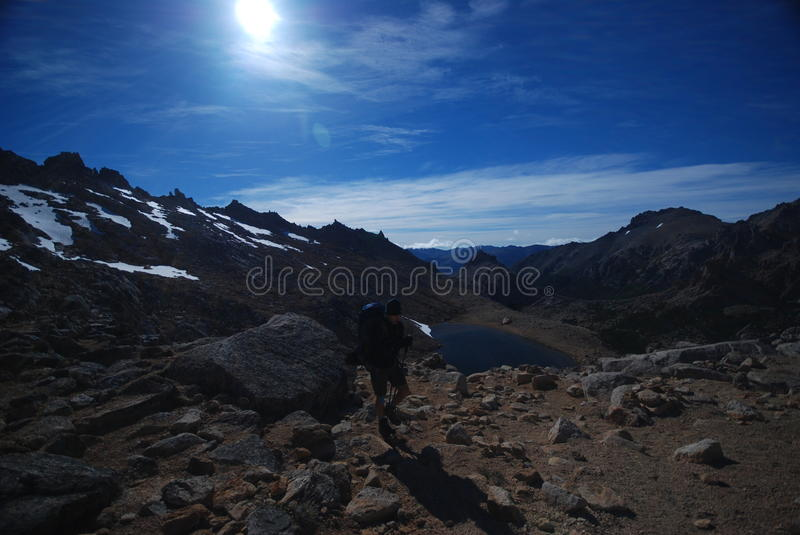 Backpacker climbing on mountains royalty free stock photo