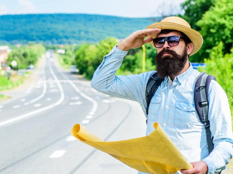 Backpacker man travelling by hitchhiking on his own. What is there. Tourist with map see familiar landmark. Seems. Finally got destination point. Tourist try to royalty free stock photography